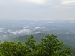 From the fire tower atop Rabun Bald you can see many miles of surrounding forest covered rolling mountains