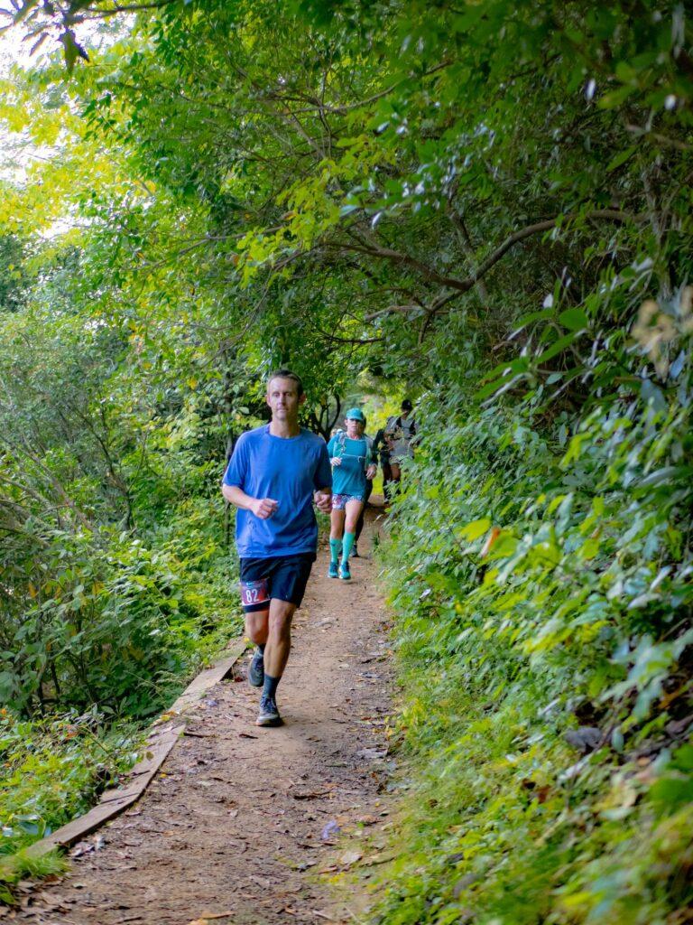 Running down single-track trail around Lake Trahlyta